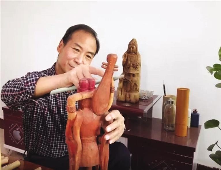 赵德成:把金塔木雕技艺传承下去